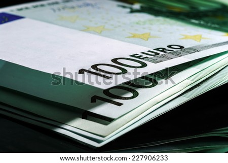 100 euro banknotes in a row. European Union Currency - stock photo