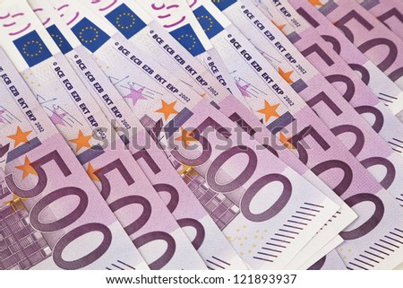 500 euro banknotes in a row. European Union Currency. Stack of 500 euro banknotes. - stock photo