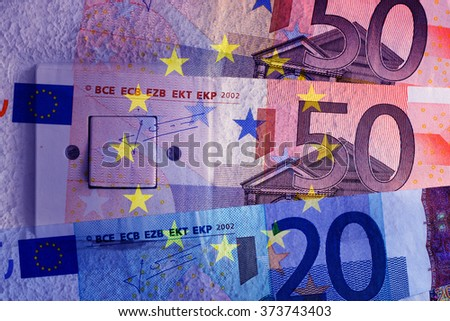 Euro banknotes, switch and EU flag - stock photo