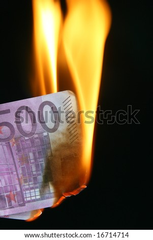 500 euro bill on fire over black background - stock photo