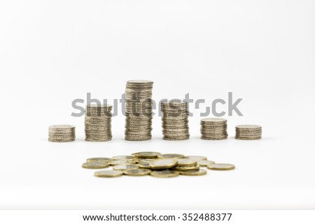 2 euro coins stacked and scattered some of 1 euro isolated on a white background  - stock photo