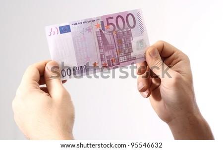 500 Euro in human hands/500 Euro - stock photo