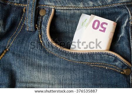 50 euro in pocket - stock photo