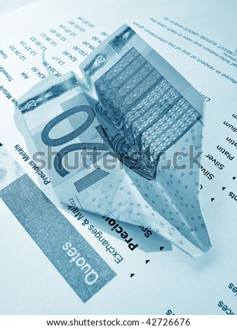 20-Euro paper airplane on a market survey - stock photo