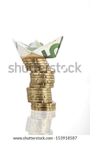 5 euro paper ship on white background - stock photo