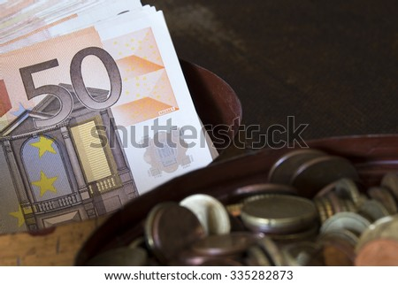 50 euros and coins. European currency - stock photo