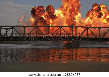 Explosion on a bridge over the river - stock photo