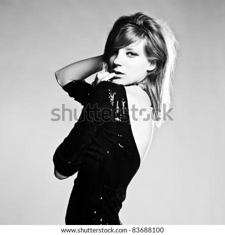 Expressive studio shot of young beautiful woman - stock photo