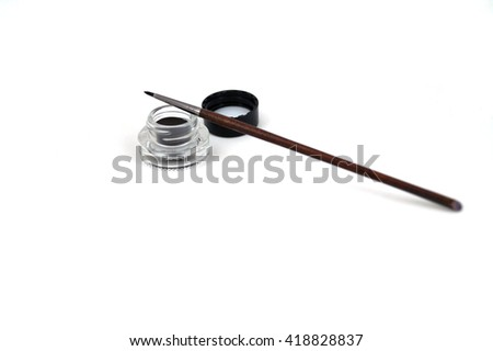 Eyeshadow and cosmetic brush on white isolated                              - stock photo