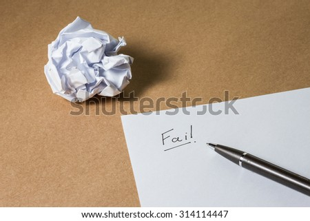 """""""Fail"""" hand writing on paper, pen and crumpled paper. Business frustrations, Job stress and Failed exam concept. - stock photo"""