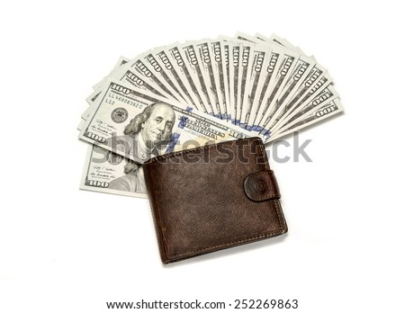 Fan of Dollar banknotes in leather wallet  - stock photo