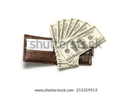 Fan of dollars on brown leather wallet / studio photography of American national currency of hundred dollar isolated on white background  - stock photo