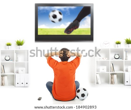 fan watching soccer game and feeling nervous - stock photo