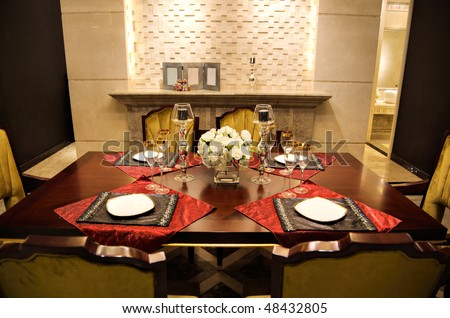 Fancy table set for dinner in a  restaurant - stock photo