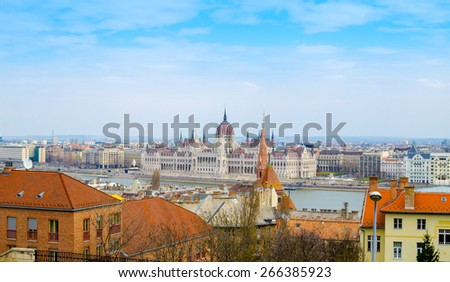 Fantastic Scenic view of the Hungarian Parliament and Pest roofs, Budapest, Hungary - stock photo