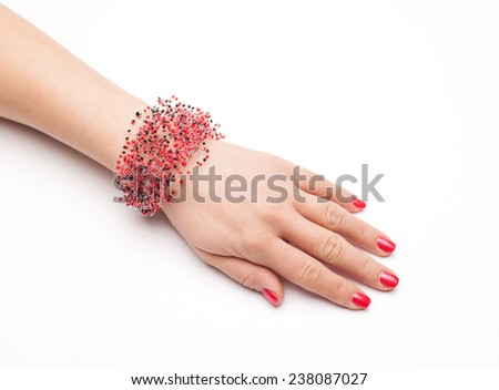 fashion bracelets on woman hand isolated on white - stock photo