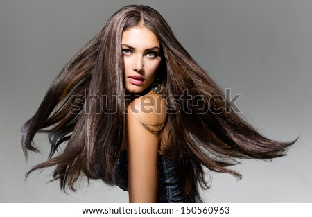 Fashion Model Girl Portrait with Long Blowing Hair. Glamour Beautiful Woman with Healthy and Beauty Brown Hair - stock photo