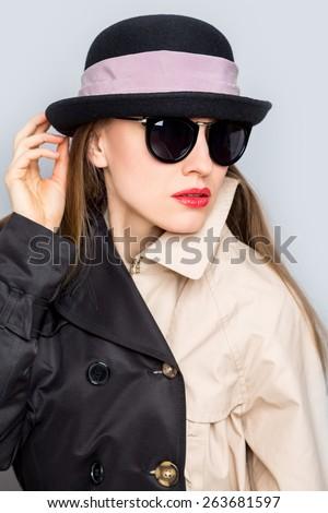 Fashion studio photo of stylish lady in hat and sunglasses - stock photo