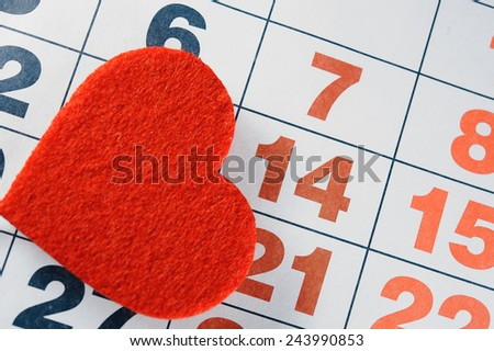 February 14, 2015 on the calendar, Valentine's day, heart from red felt - stock photo