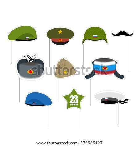 23 February Photo props. National holiday in Russia. Defender of fatherland day. Military hat and peakless Cap. Hats soldiers. Green and blue beret. Mustache and green star.  - stock photo