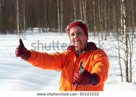 Female cross country skier gives the thumbs up sign - stock photo