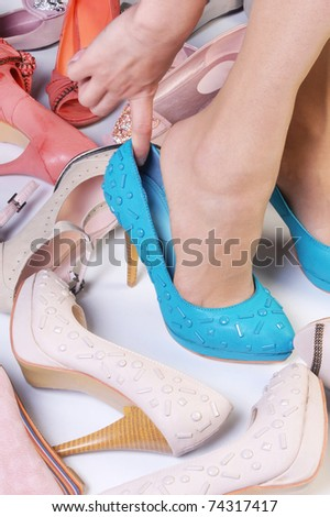 Female legs wearing high heeled shoes - stock photo