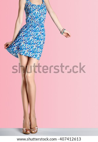 Female legs. Woman in fashion sundress and high heels. Female sexy long legs, model pose, stylish flower sundress, summer glamour shoes on legs. Unusual creative. Sexy girl legs.Fashion female outfit - stock photo