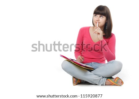 female student thinking with note pad. - stock photo