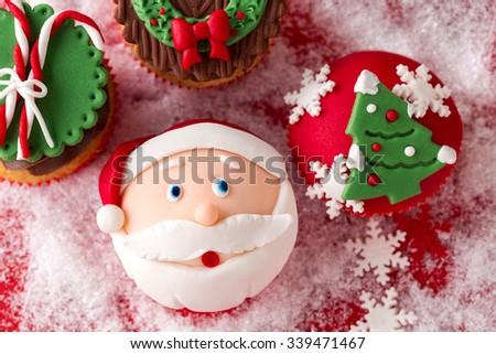 festive Christmas mini desserts over snowy background  - stock photo