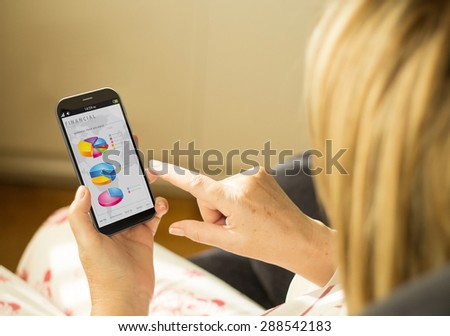 financial  accounting and banking business concept: woman with a 3d generated smartphone with finances app on the screen. All screen graphics made up. - stock photo