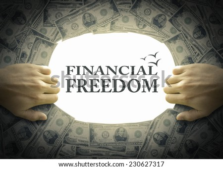 """""""Financial Freedom"""" text on white background behind hand opening the exit way of money bills. - stock photo"""
