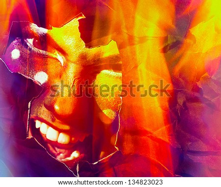 fire face.Young girl looks in shot through burning paper - stock photo