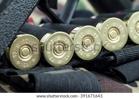 Firearm Pistol  on military camouflage background - stock photo