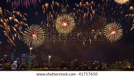 Fireworks over city - stock photo