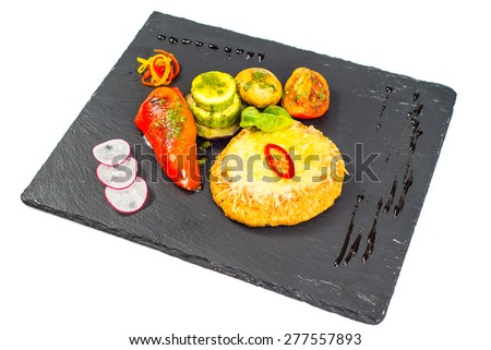 fish cutlets served with vegetables and bread - stock photo