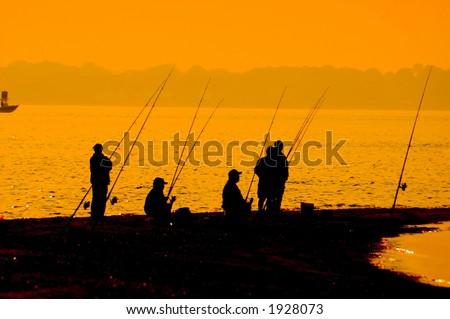 5 fishermen waiting - stock photo