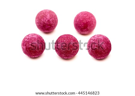 Five milk chocolate truffles candies pralines in pink fruit sugar on white background, close up - stock photo