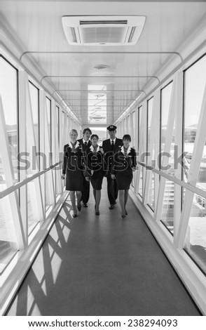 flight assistants, soft focus - stock photo