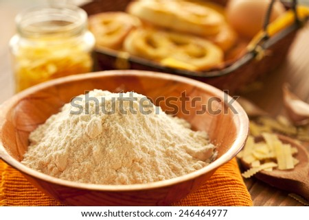 flour and pasta on the kitchen table - stock photo