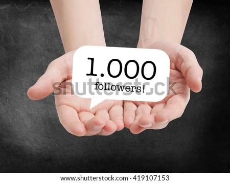 1000 followers written on a speechbubble - stock photo