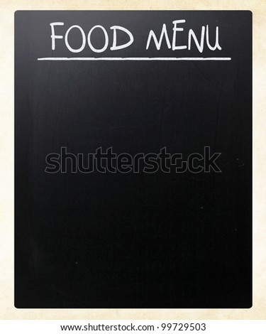 """Food menu"" handwritten with white chalk on a blackboard - stock photo"