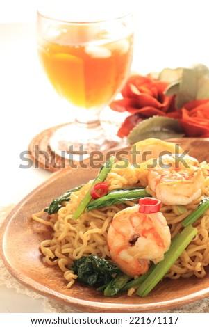 food, shrimp and green vegetable fried noodles, mi goreng - stock photo
