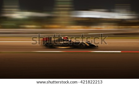 Formula 2.0 race car racing at high speed with motion blur on the background of the city in the dark - stock photo