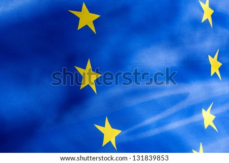 Fragment of a flag of  European Union in the sunshine - stock photo