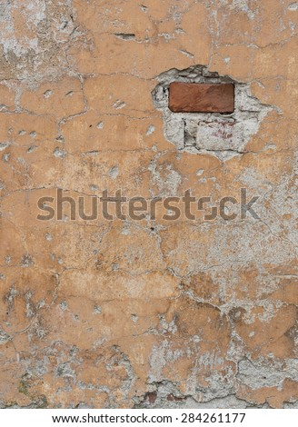 Fragment of old weathered brick wall as background - stock photo