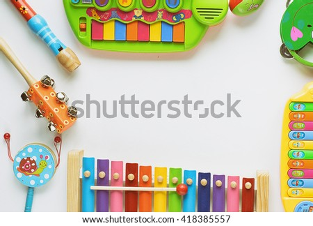 frame made of music accessories for children on white backgroun - stock photo