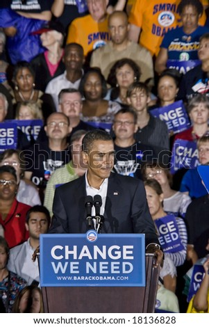 FREDERICKSBURG,VA - SEPT 27: Democratic presidential candidate Barack Obama gestures as he speaks to supporters at a rally on September 27, 2008 in Fredericksburg, Virginia. - stock photo