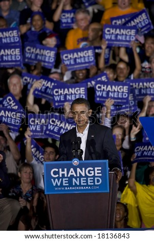 FREDERICKSBURG,VA - SEPT 27: Democratic presidential candidate Barack Obama pauses as he speaks to supporters at a rally on September 27, 2008 in Fredericksburg, Virginia. - stock photo