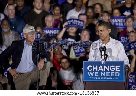 FREDERICKSBURG,VA - SEPT 27: Democratic presidential candidate Barack Obama (R) speaks to supporters while VP candidate Biden looks on at a rally on September 27, 2008 in Fredericksburg, Virginia. - stock photo