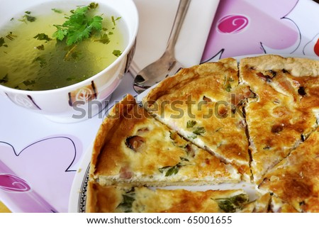 French cuisine.Chicken broth.Quiche- oven-baked dish that is based on a custard made from eggs and milk - stock photo
